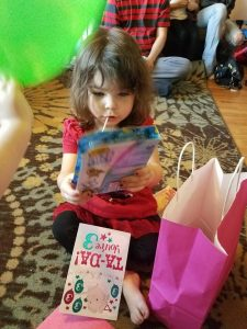 NaNoWriMo Diary - My Granddaughter opening gifts.